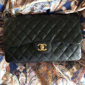 Chanel double flap jumbo black caviar gold